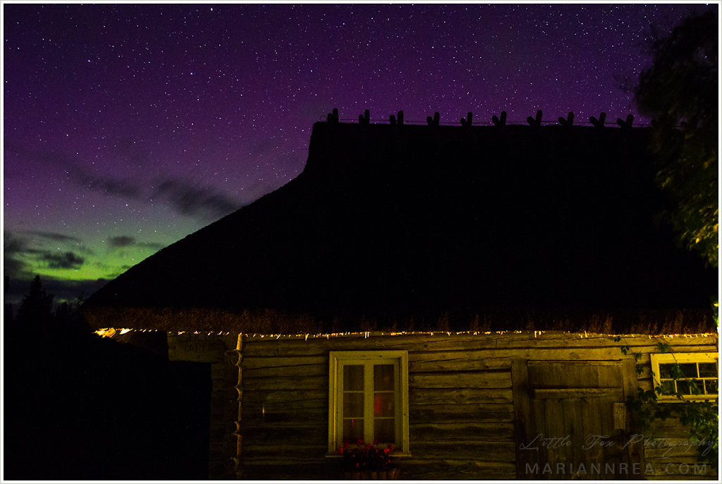 Cottage under the aurora borealis